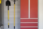 Red-Cabinet-w-Drawers-Shovel-Rake-on-Grey-Slatwall-Aug-2013