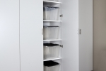 White-Tall-Cabinet-Door-Open-with-Storage-Bins