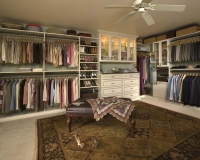 Walk In Closet in Antique White finish with Premier Recessed Panels and Mirror