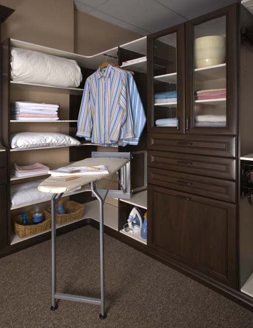 Linen closet with dlx. ironing board in Silver Mist finish. Closet in Chocolate Pear and White melamine finishes